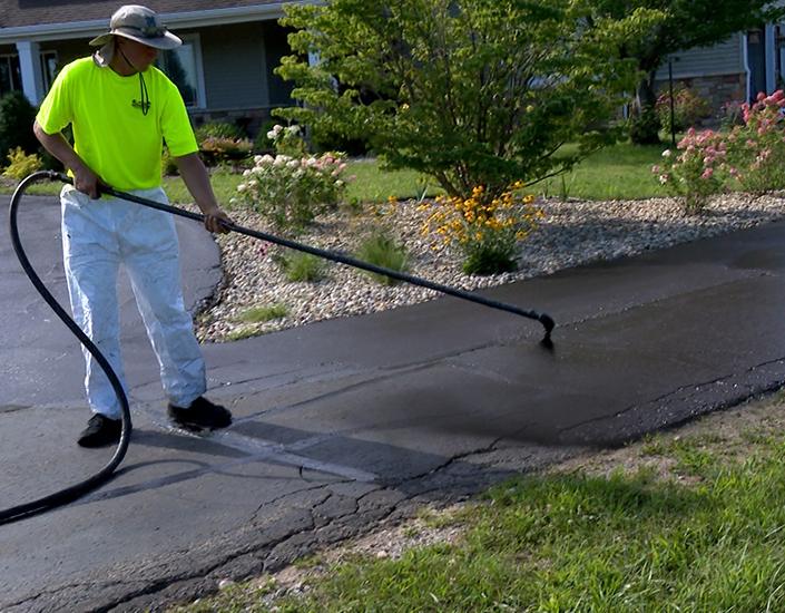 Guy sealing asphalt driveway 1